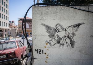 stefano majno israel west bank wall banksy graffiti angel betlehem.jpg.jpg