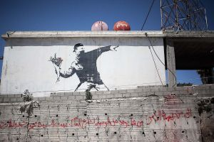 stefano majno israel west bank wall banksy graffiti flower thrower.jpg.jpg