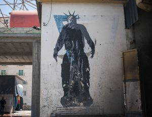 stefano majno israel west bank wall banksy graffiti liberty statue money.jpg.jpg