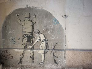 stefano majno israel west bank wall banksy graffiti street art baby child soldier perquisition.jpg.jpg