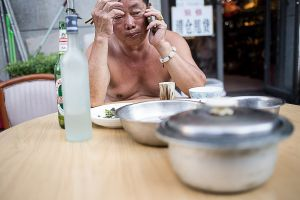 beijing pechino china by rail stefano majno eating man asia.jpg