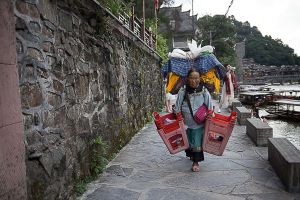 fenghuang china by rail stefano majno asia miao old woman.jpg