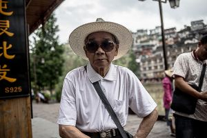 fenghuang china by rail stefano majno asia old man.jpg