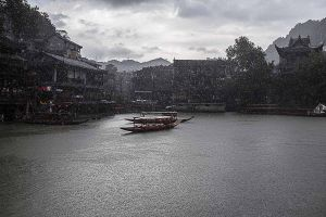 fenghuang china by rail stefano majno asia raining.jpg
